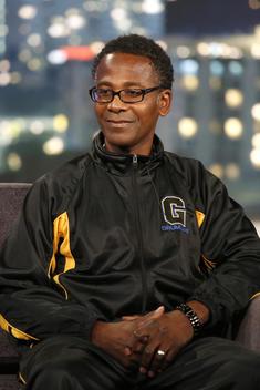 man with drum line jacket sitting